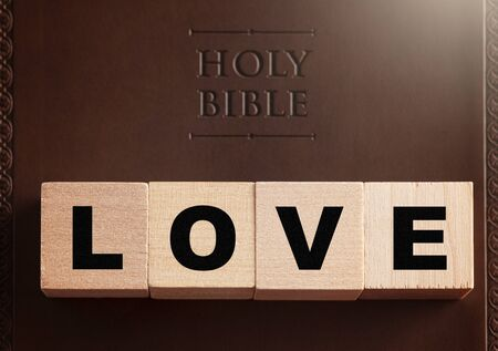 Love Spelled in Blocks on a Brown Leather Holy Bible