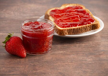 Classic Strawberry Jam on a Rustic Wooden Table