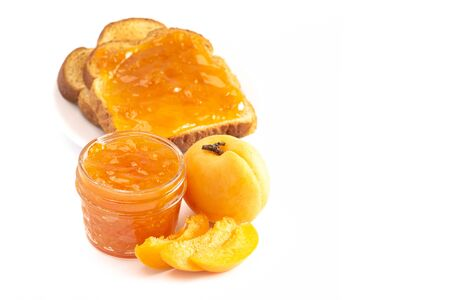 A Jar of Homemade Apricot Jam Isolated on a White Background