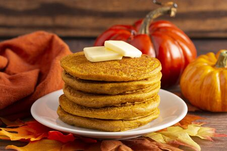 A Stack of Pumpkin Spice Flavored Pancakes on a Wooden Table