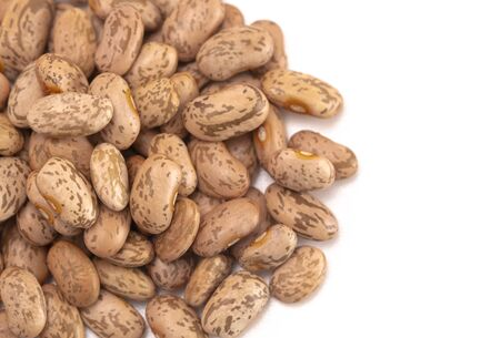 A Pile of Pinto Beans Isolated on a White Background Stock Photo