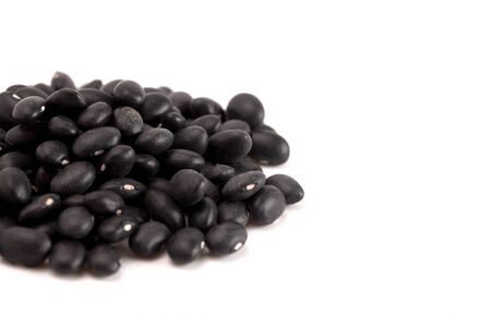 A Pile of Dry Black Beans Isolated on a White Background