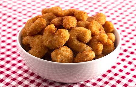 Bowl of Popcorn Shrimp on a Red Gingham Table Cloth