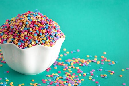 Round Glittery Rainbow Sprinkles for Decorating your Baked Goods Imagens
