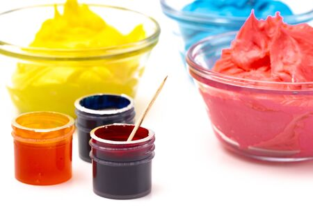 Opened Pots of Red Yellow and Blue Gel Food Coloring for Baking Isolated on a White Background Stock Photo