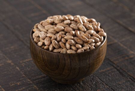 A Bowl of Pinto Beans on a Rustic Wooden Table Stock Photo