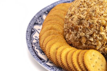 A Cheeseball with Crackers Perfect for Holiday Paries