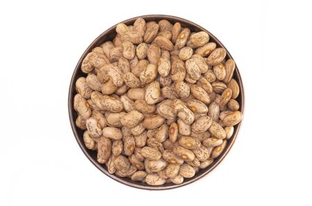 A Bowl of Pinto Beans Isolated on a White Background Stock Photo
