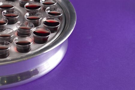 Elements of the Holy Communion or Lords Supper on a Purple Table