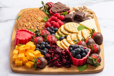 Chocolate Covered Strawberries and Cheese Sweet Charcuterie Board on a Marble Counter
