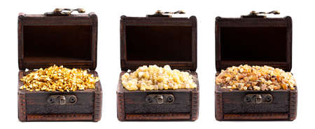 Gold Frankincense and Myrrh in three Chests Isolated on a White Background