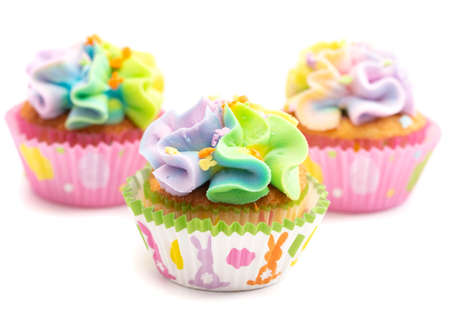 Pastel Rainbow Frosted Easter Cupcakes Isolated on a White Background