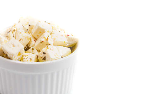 Bowl Filled with Cubed Feta Cheese Isolated on a White Background