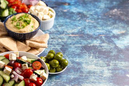 Fresh Greek Food on a Rustic Blue Wooden Background
