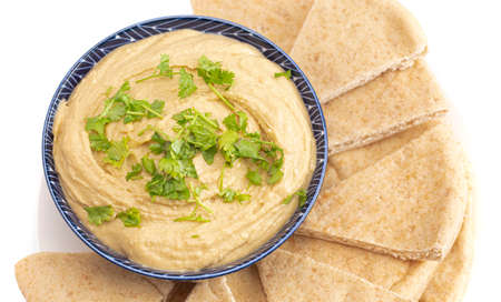 A Bowl of Fresh Hummus on a White Background