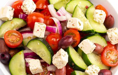 A Bowl of Fresh Greek Salad with Cucumbers Tomatoes Olives and Feta Cheese 版權商用圖片
