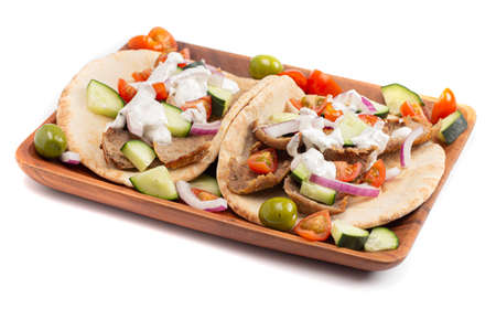 Gyro with Vegetables and Garlic White Sauce on a White Background 版權商用圖片