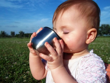 Cute baby drinking water  photo