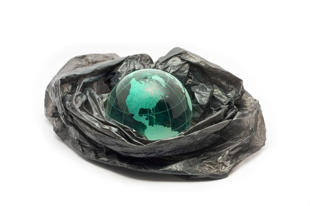 Globe in plastic shopping bag photo