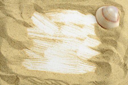 Sand and seashells frame photo