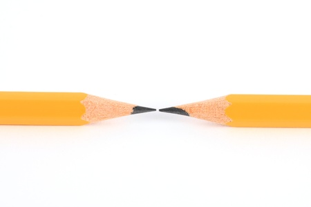 Two pencils in opposite isolated on white