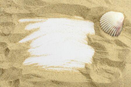Sand and seashell frame photo