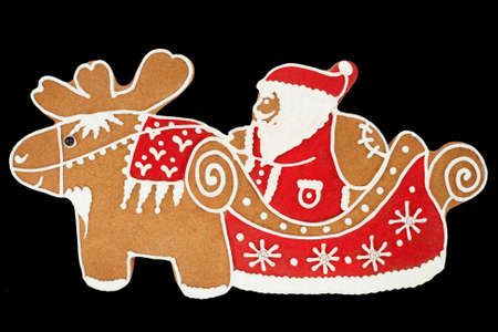 Santa Claus gingerbread isolated on black photo