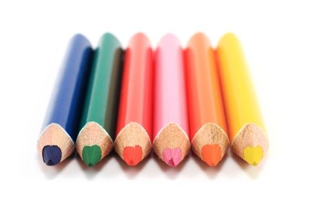 Colored pencils on the white background photo