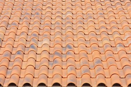 Terracotta roof tiles. Architectural details.