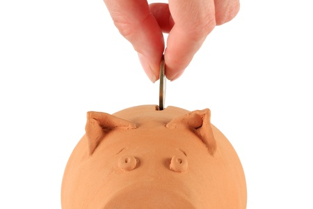 Piggy bank being loaded photo