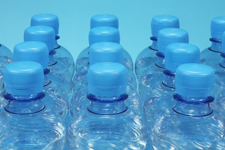 Bottled mineral water on blue background photo