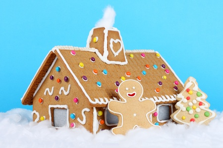 Gingerbread house with gingerbread man and christmas tree photo