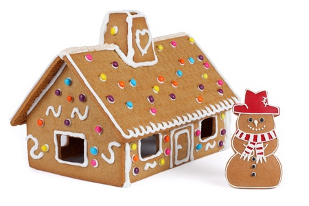 Gingerbread House with Gingerbread Snowman, Isolated photo