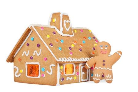casita de dulces: Casa de pan de jengibre con Gingerbread Man, aisladas sobre fondo blanco