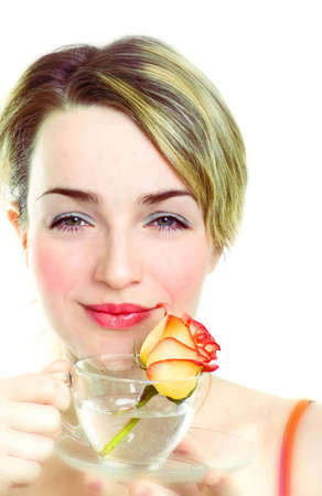 Smiling girl with rose in the cup Stock Photo - 854147