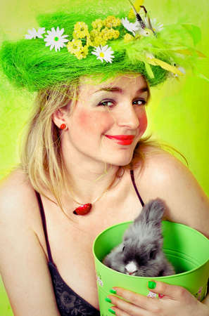 Spring girl holding a bunny in a basket photo