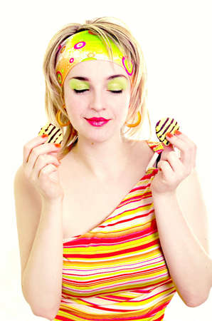 Cute girl going to eat a striped cookie Stock Photo - 854112