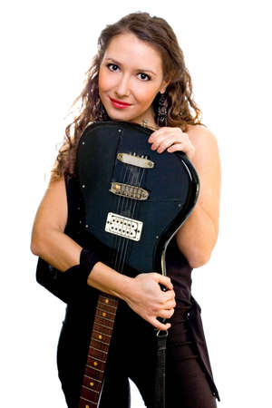 Attractive brunette hugging an electro guitar photo
