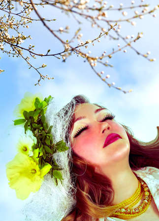 Girl under the cherry tree in bloom photo