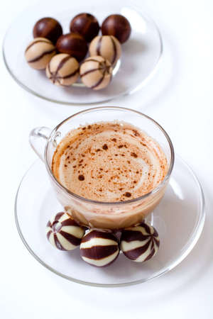 Cup of cappucino and chocolate candies photo