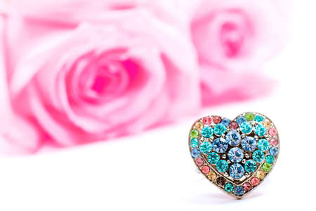 Beautiful heart-shaped ring and pink roses (Shallow DOF) photo