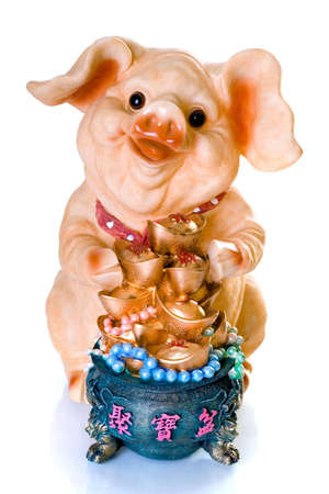 Ceramic chinese new year pig gift with hieroglyphs of Happy New Year photo