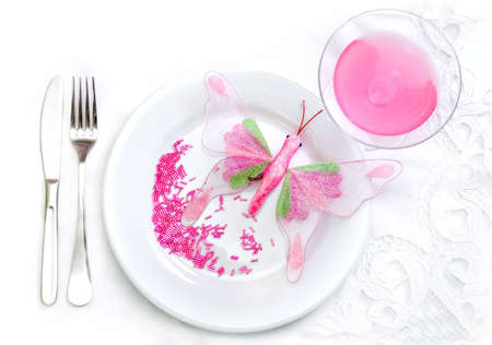 butterfly knife: Glamour food concept - plate, polka glass, fork, knife, pink butterfly