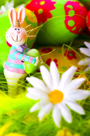 Easter bunny and colorful painted eggs photo