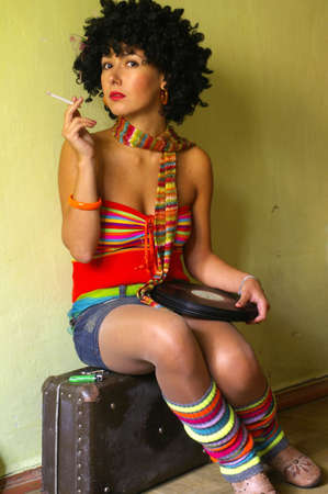 strip dance: Smoking cute curly disco girl