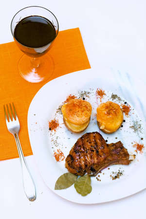 Baked Pork ribs and potato baked with cheese photo