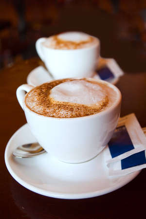 magnificent: Two cappuccino cups with magnificent milk foam and cinnamon dressing Stock Photo
