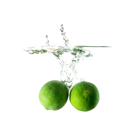 water plants: Limes splash on water, isolated on white background. Use for fresh drinks advertising. Stock Photo