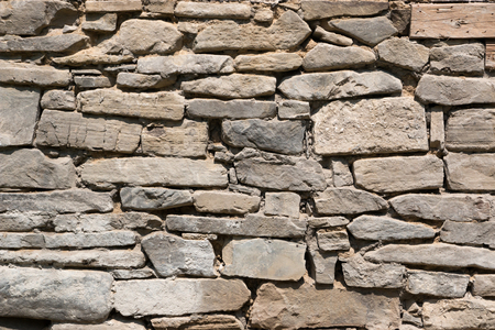 brownstone: Part of old stone wall, for background or texture Stock Photo