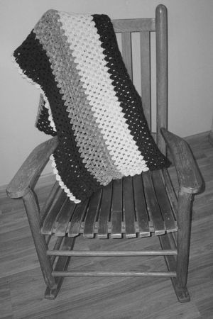 antique chair: Antique Slat Rocking Chair B&W Stock Photo